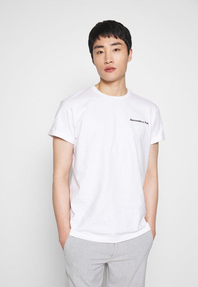 HEAVYWEIGHT - T-shirt con stampa - white