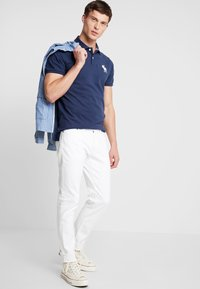 Abercrombie & Fitch - EXPLODED - Polo shirt - navy - 1