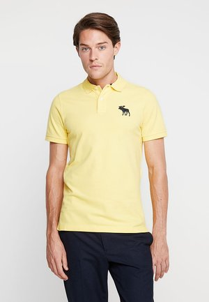 EXPLODED  - Polo shirt - yellow