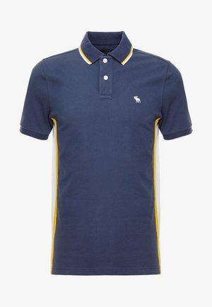 MODERN - Poloshirt - navy/yellow