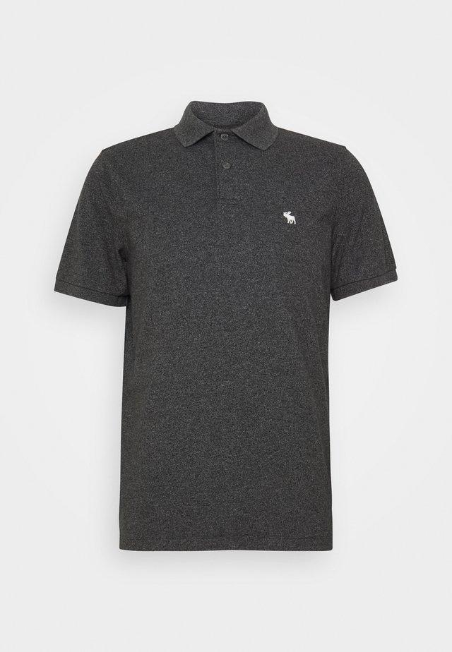 SPRING NEUTRAL CORE  - Polo shirt - black