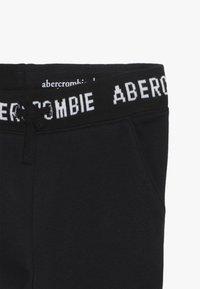 Abercrombie & Fitch - LOGO SLIM - Teplákové kalhoty - black - 3