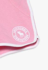Abercrombie & Fitch - YOUNG CORE CURVED  - Teplákové kalhoty - pink - 4