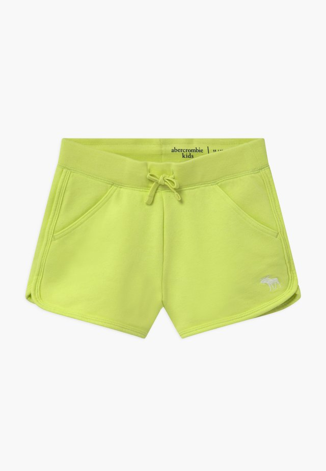 CURVED - Tracksuit bottoms - lime