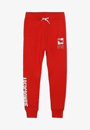 CORE LOGO - Tracksuit bottoms - red