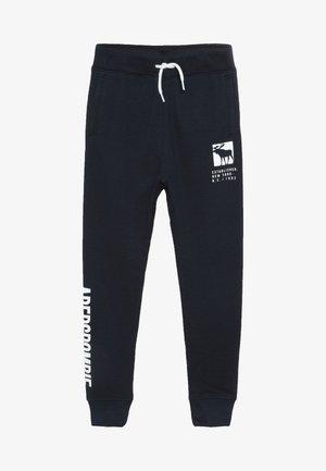 CORE LOGO - Spodnie treningowe - navy solid