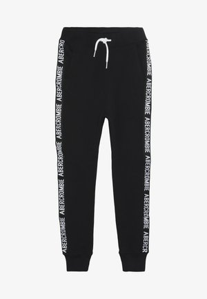 TAPE IT TO THE LIMIT - Tracksuit bottoms - black