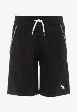 LOGO TAPE  - Pantalon de survêtement - black