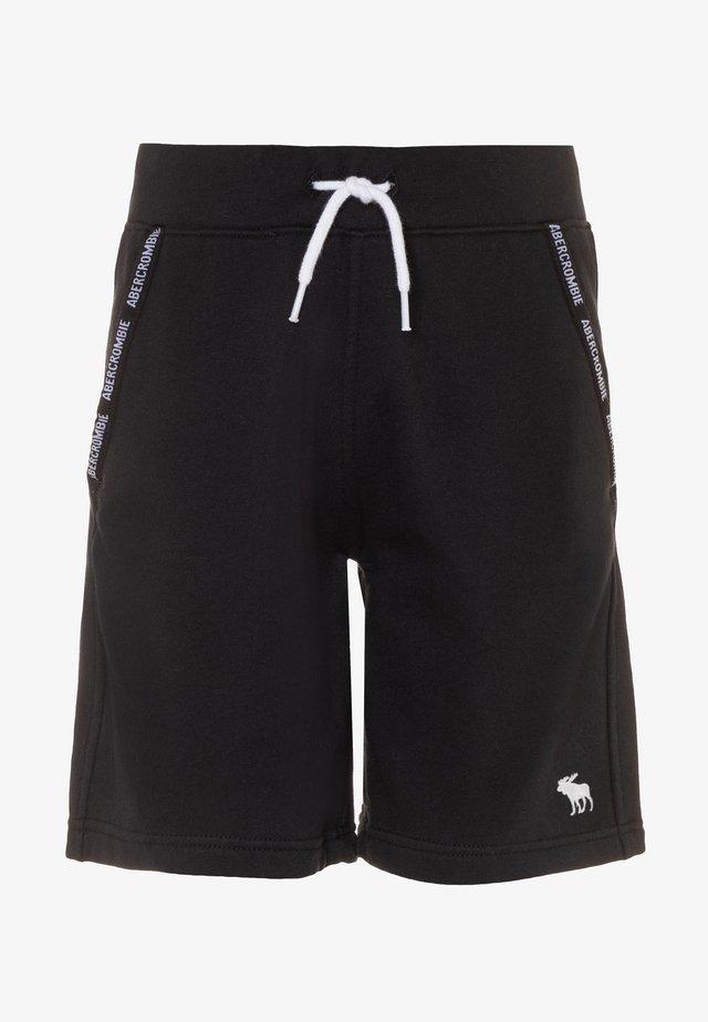LOGO TAPE  - Jogginghose - black