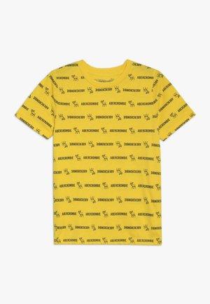 PATTERN - T-shirt z nadrukiem - yellow