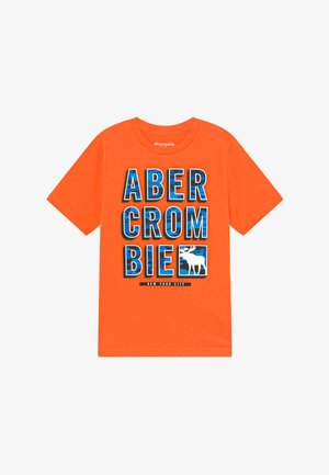 TRIPPY LOGO - Print T-shirt - orange