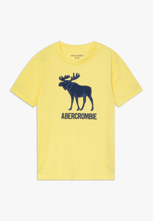 TECH LOGO - Print T-shirt - yellow