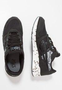 ASICS - HYPERGEL-LYTE - Stabilty running shoes - black - 1