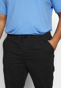 Another Influence - UTILITY PANTS IN PLUS - Cargo trousers - black - 5