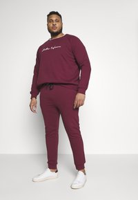 Another Influence - Tracksuit bottoms - burgundy - 1
