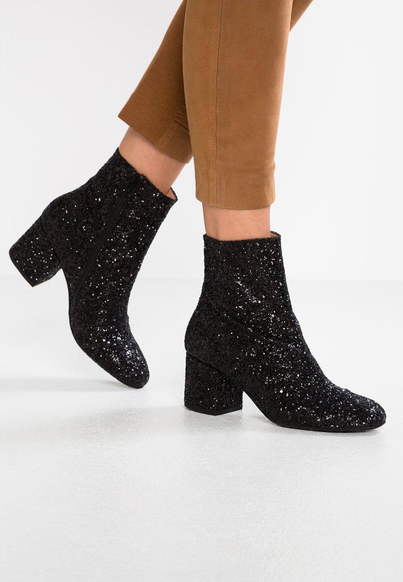ANGULUS - Classic ankle boots - black glitter