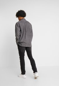 AllSaints - CIGARETTE - Džíny Slim Fit - washed black - 2