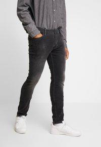AllSaints - CIGARETTE - Džíny Slim Fit - washed black - 0