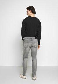 AllSaints - REX DAMAGED - Jeans slim fit - grey - 2