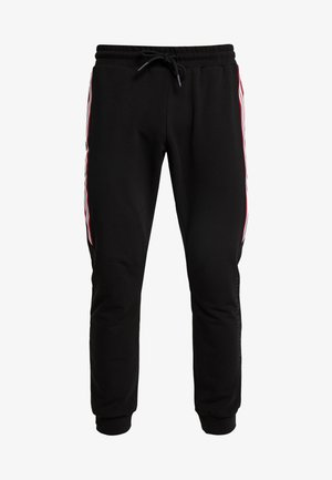 PANTS WITH LATERAL BAND AND PRINT - Joggebukse - black