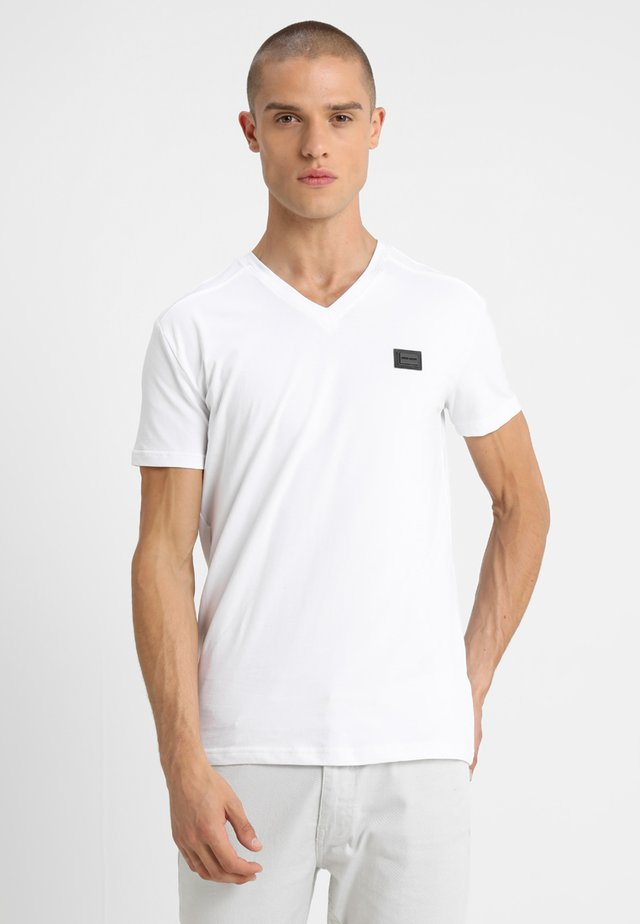 SPORT V-NECK WITH METAL PLAQUETTE - T-Shirt basic - bianco