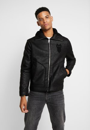 SHEARLING - Giacca in similpelle - black
