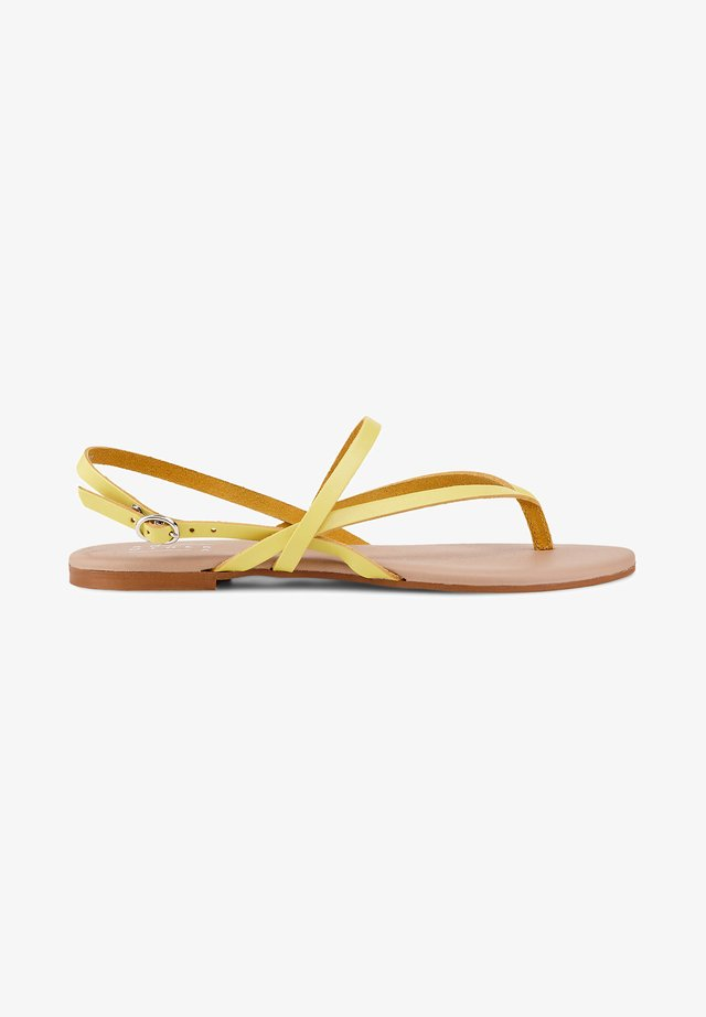ZEHENTRENNER - T-bar sandals - gelb