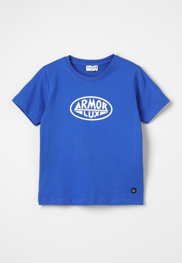 T-shirts med print - etoile