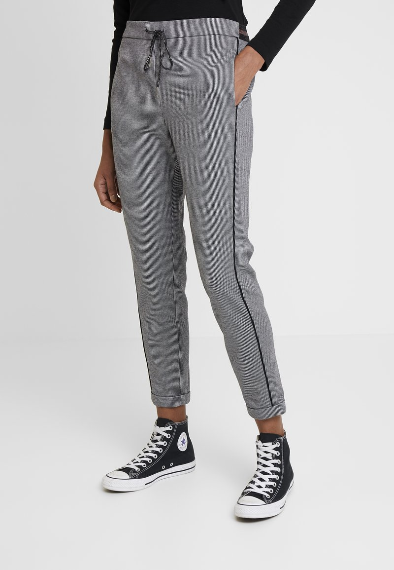Aaiko - POPPIN PIED - Tracksuit bottoms - black