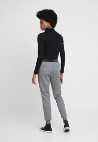 Aaiko - POPPIN PIED - Tracksuit bottoms - black - 3