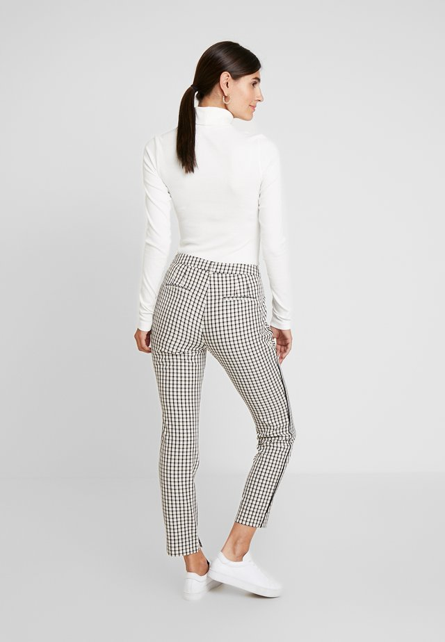 PARIEN CHECK - Trousers - nude