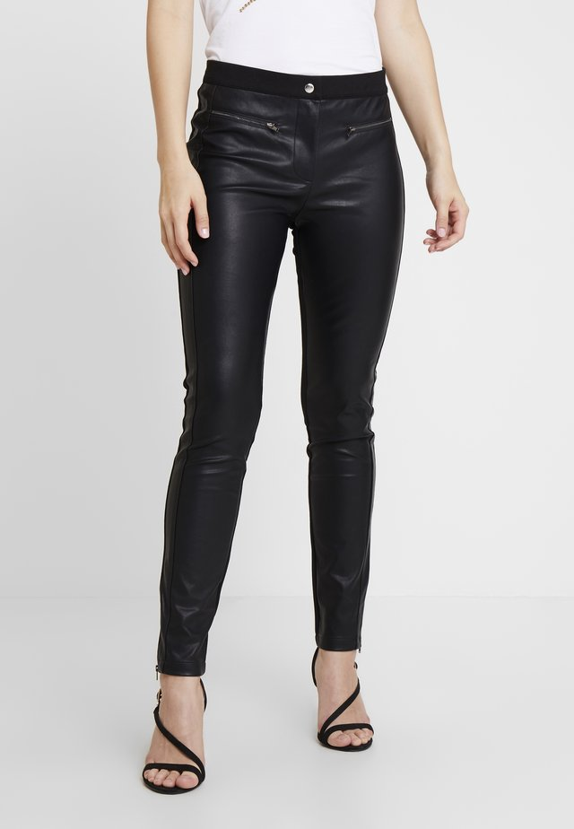 PERSY - Trousers - black