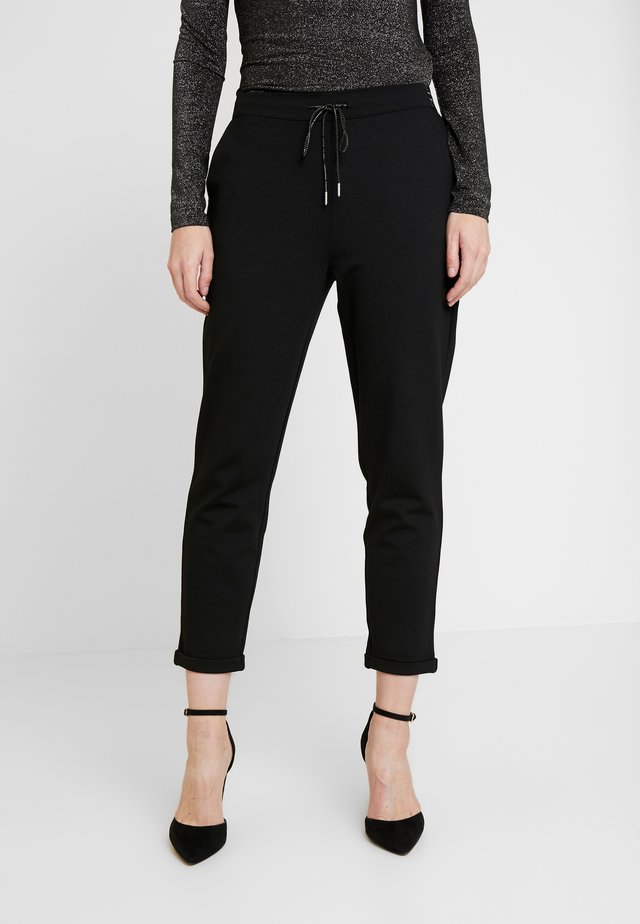POPPIN - Trousers - black