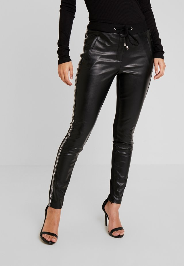 SOSA STUDS - Trousers - black