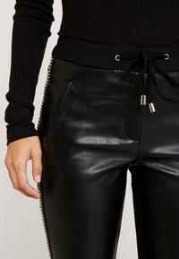 Aaiko - SOSA STUDS - Kalhoty - black - 5