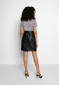 Aaiko - PATIA STUDS - A-line skirt - black - 2