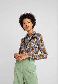 Aaiko - VILOU CAMO - Button-down blouse - ginger - 0
