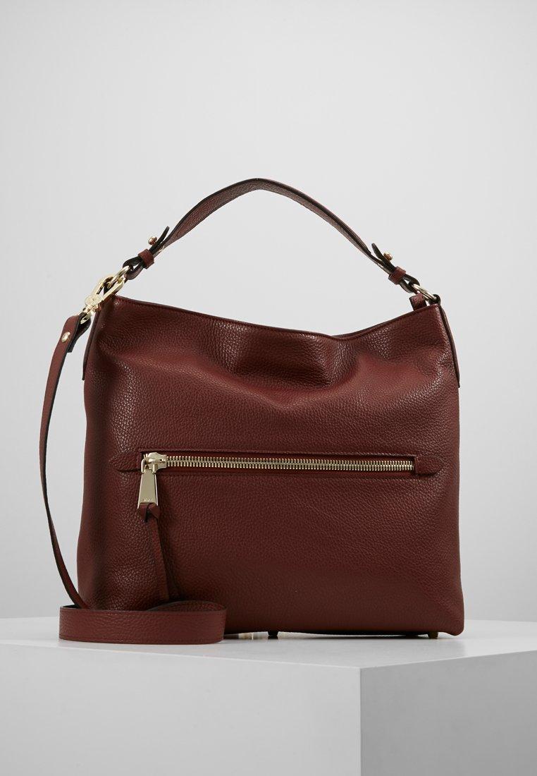 Abro - Handväska - rust
