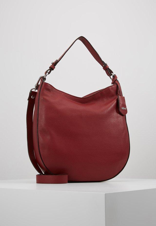 Käsilaukku - ruby