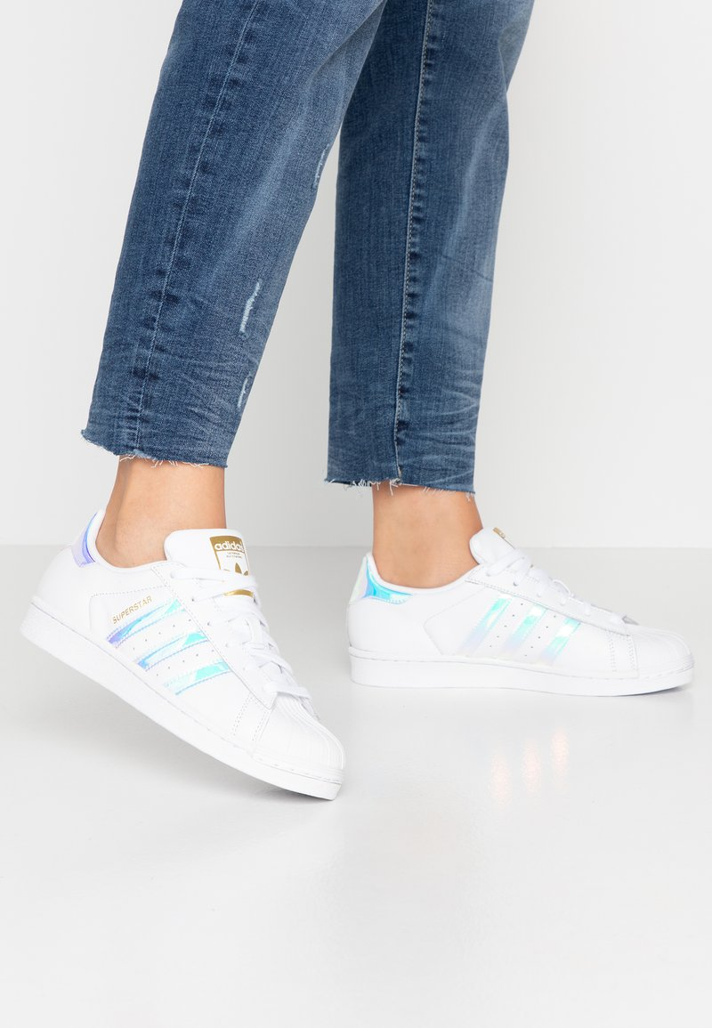 adidas Originals - SUPERSTAR SHNY STRIPES SHOES - Trainers - footwear white/super collegiate/gold metallic