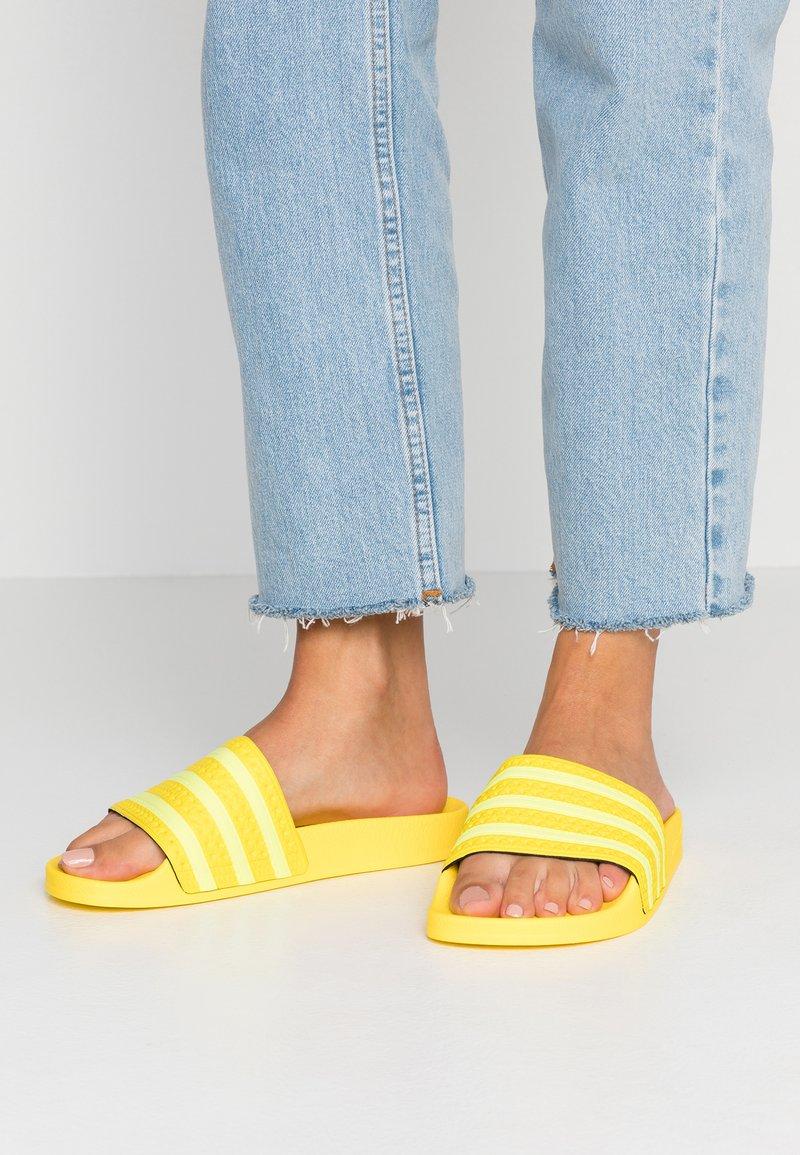 adidas Originals - ADILETTE - Sandalias planas - yellow/semi frozen