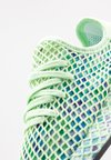 adidas Originals - DEERUPT RUNNER - Sneakers - glow green/core black