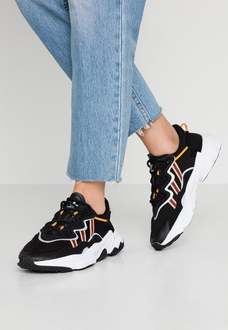 adidas Originals - OZWEEGO  ADIPRENE+ RUNNING-STYLE SHOES - Sneakers basse - core black/purple beauty/flash orange