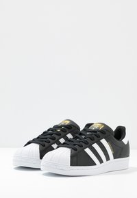 adidas Originals - SUPERSTAR  - Sneaker low - core black/footwear white - 4