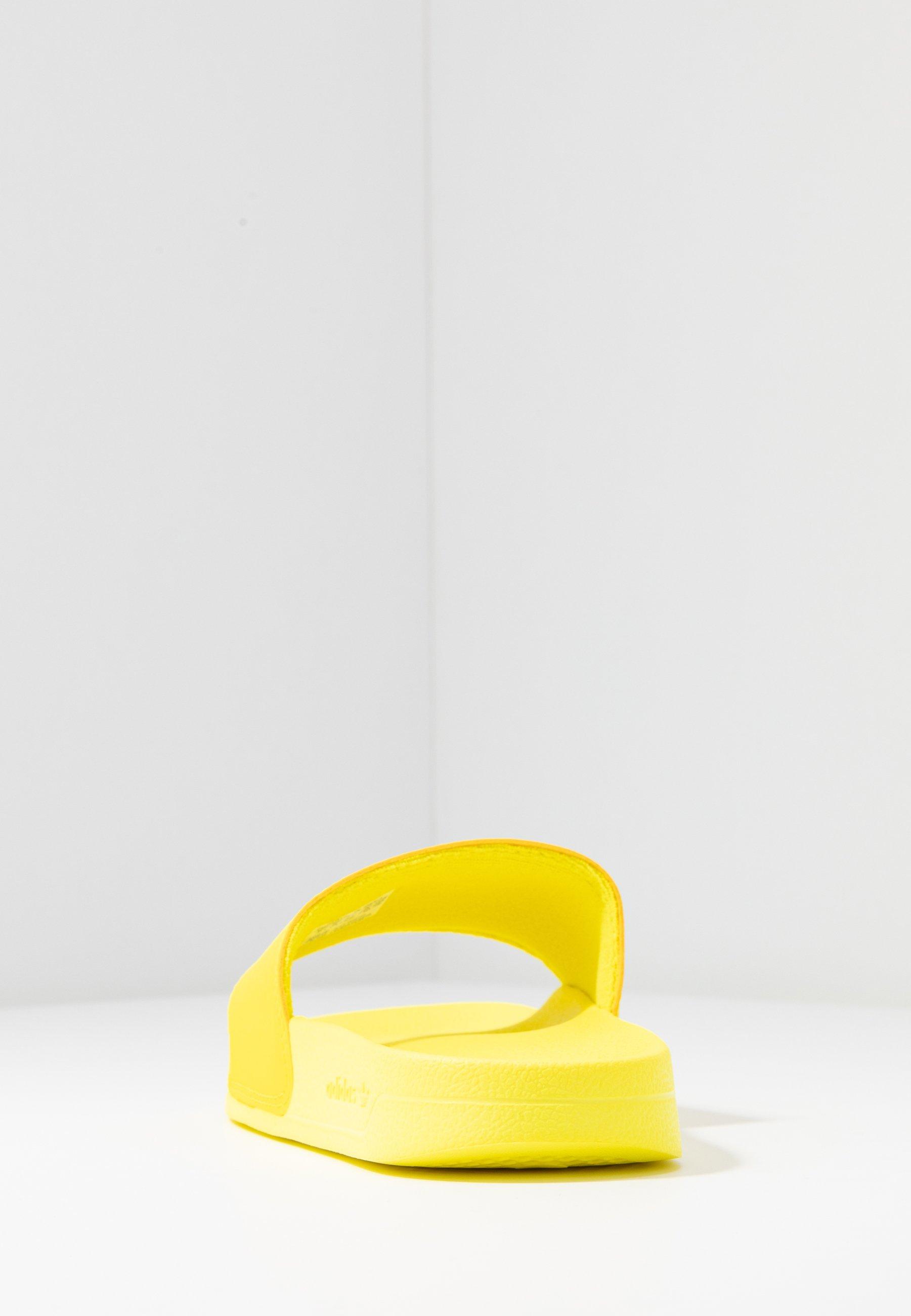 adidas Originals ADILETTE LITE - Slip-ins - shock yellow/footwear white