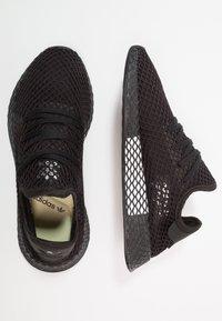 adidas Originals - DEERUPT RUNNER - Sneakers - core black/footwear white - 1
