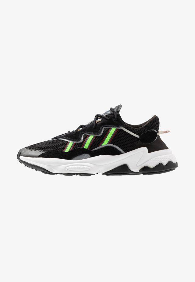 OZWEEGO - Trainers - core black/solar green/onix