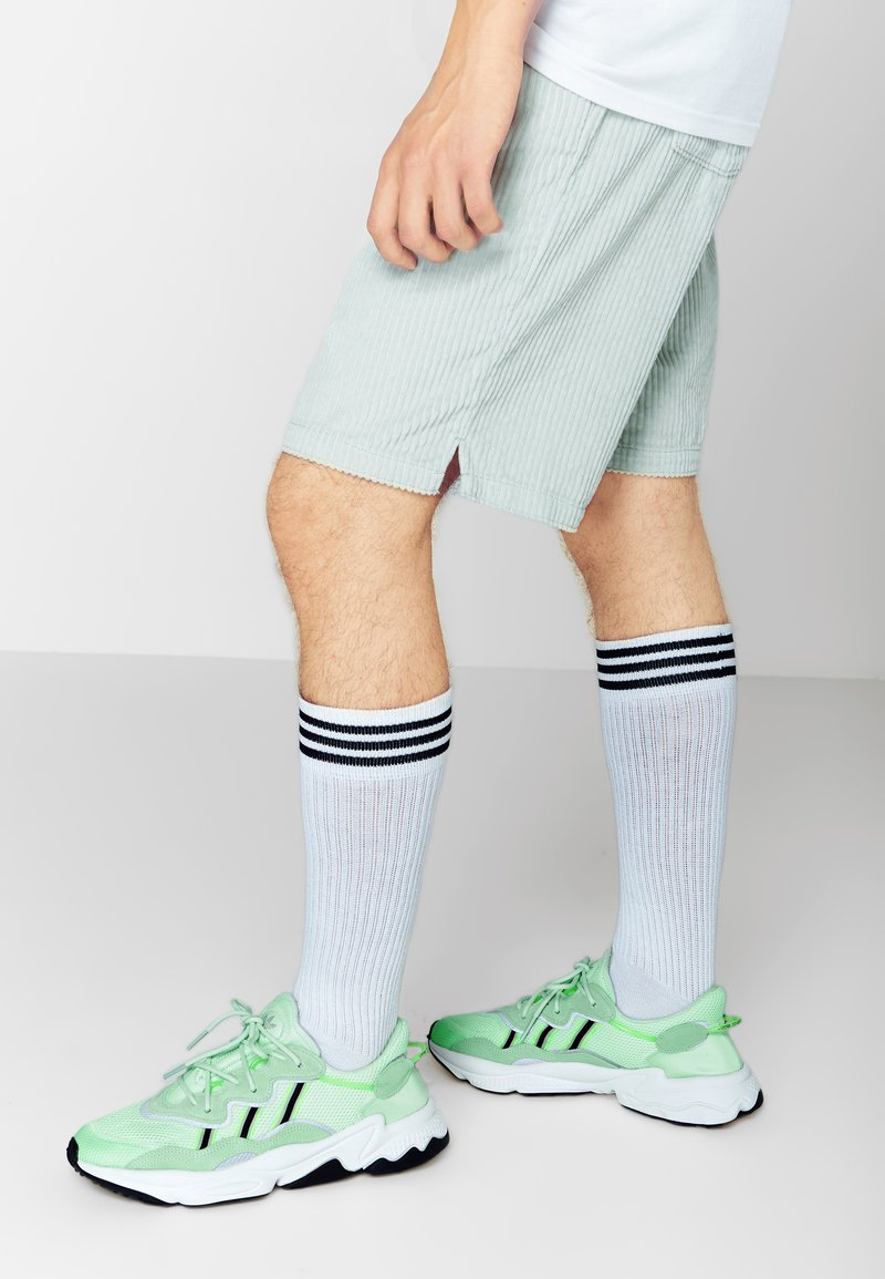 adidas Originals - OZWEEGO ADIPRENE+ RUNNING-STYLE SHOES - Sneaker low - glow green/core black/solar yellow