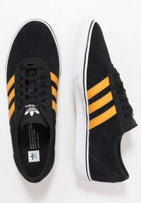 adidas Originals - EASE - Sneakersy niskie - core black/tactile yellow/footwear white - 1