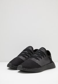 adidas Originals - DEERUPT RUNNER - Baskets basses - core black/silver metallic